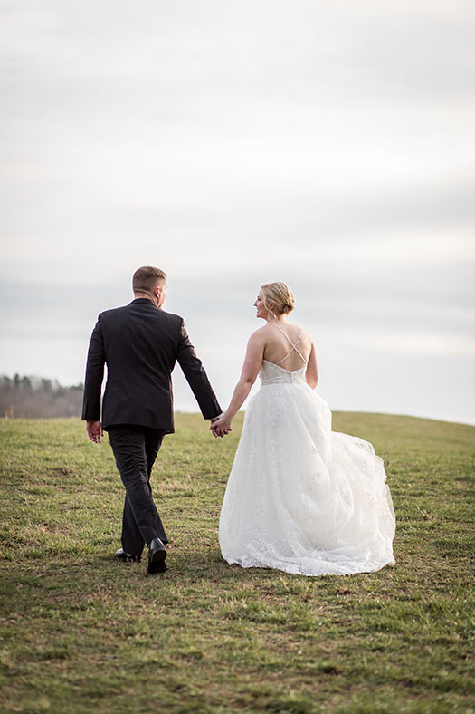 Bride and Groom walking away holding hands