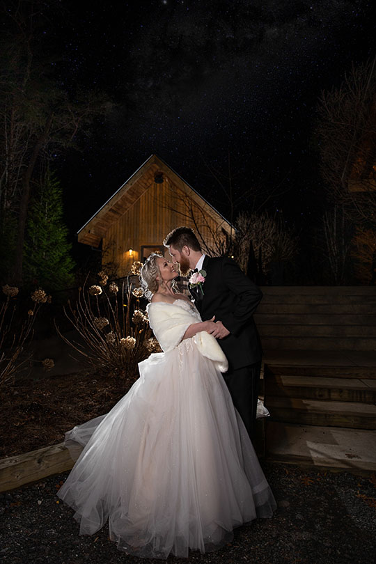 Bride and groom nighttime portraits at the Juliette Chapel