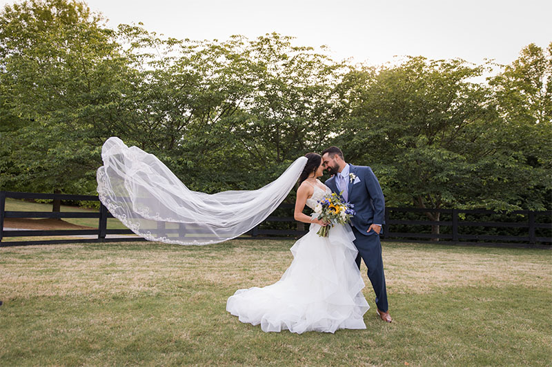 Bride and Groom with a flowing veil